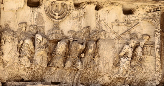 Triumphant Romans carry the menorah, trumpets and table of showbread plundered from the Temple of Jerusalem (Arch of Titus, Rome)
